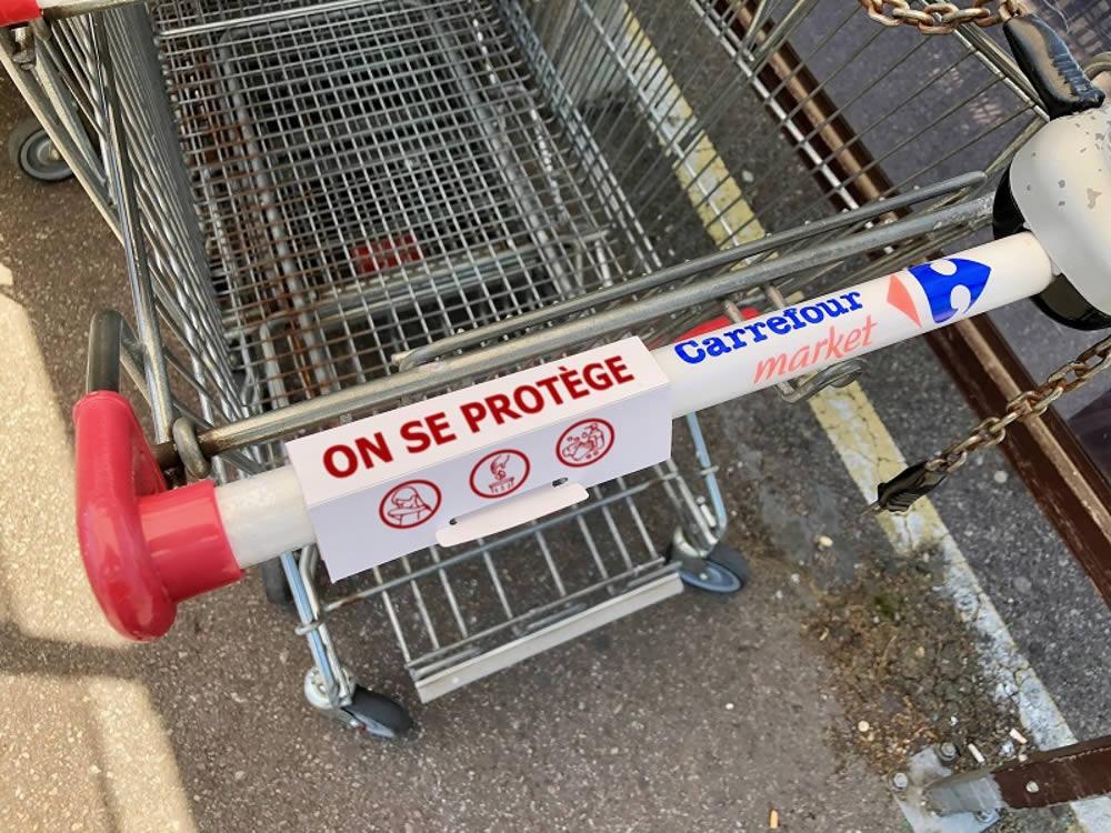 protection caddie anti covid19 en carton publicitaire