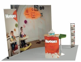 support de communication pour salon Huggies